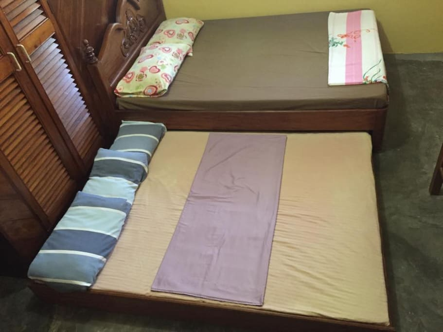 Pull-out bed and cabinet