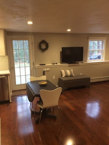 Private entrance overlooking woods and patio with gas grill. Open concept living/dining/full kitchen.