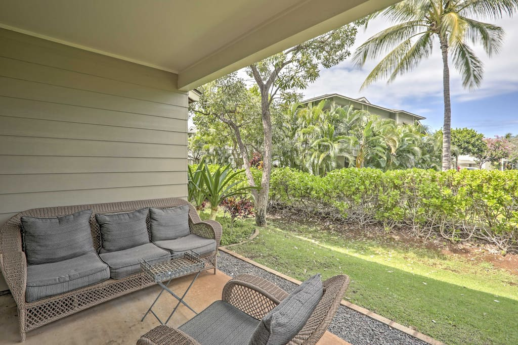 Relax on the private patio while enjoying a refreshing beverage.