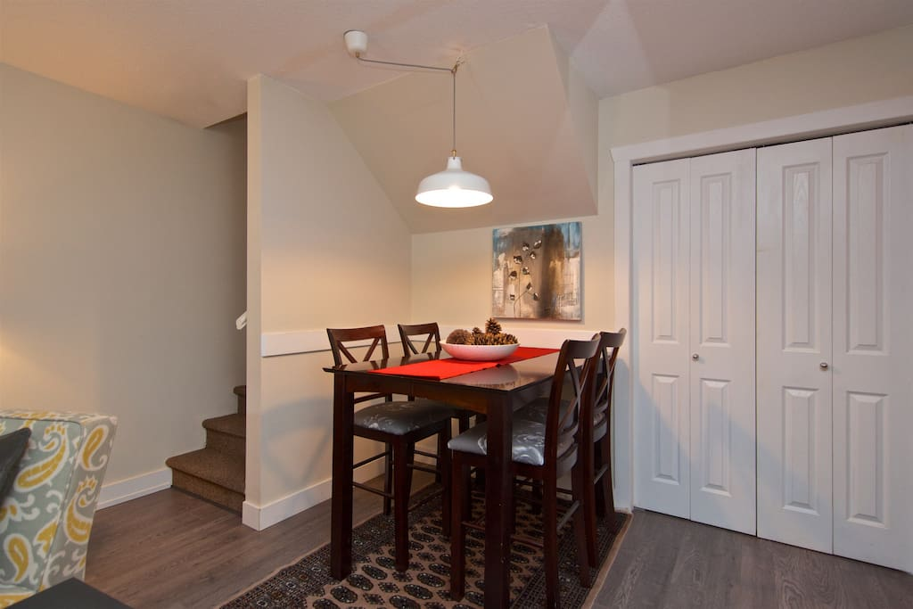 Dining Area on the open concept main floor - table extends to seat six.