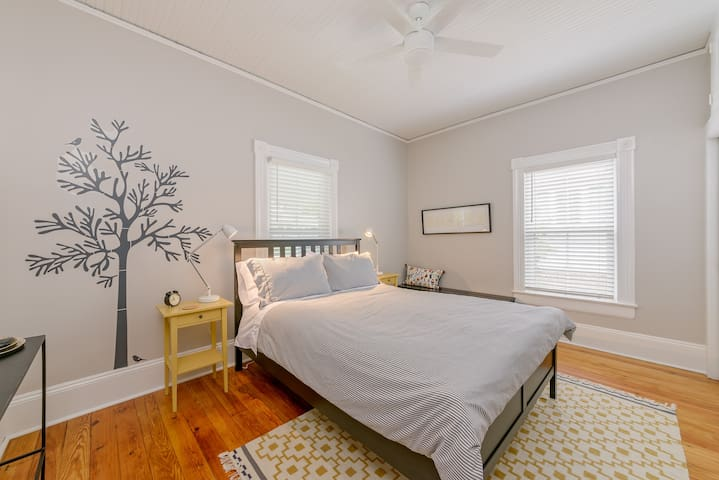 Charming front bedroom with en-suite bathroom, and remote control ceiling fan.