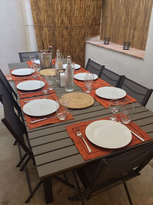 Dining for 8 on the terrace adjacent to the kitchen for convenience