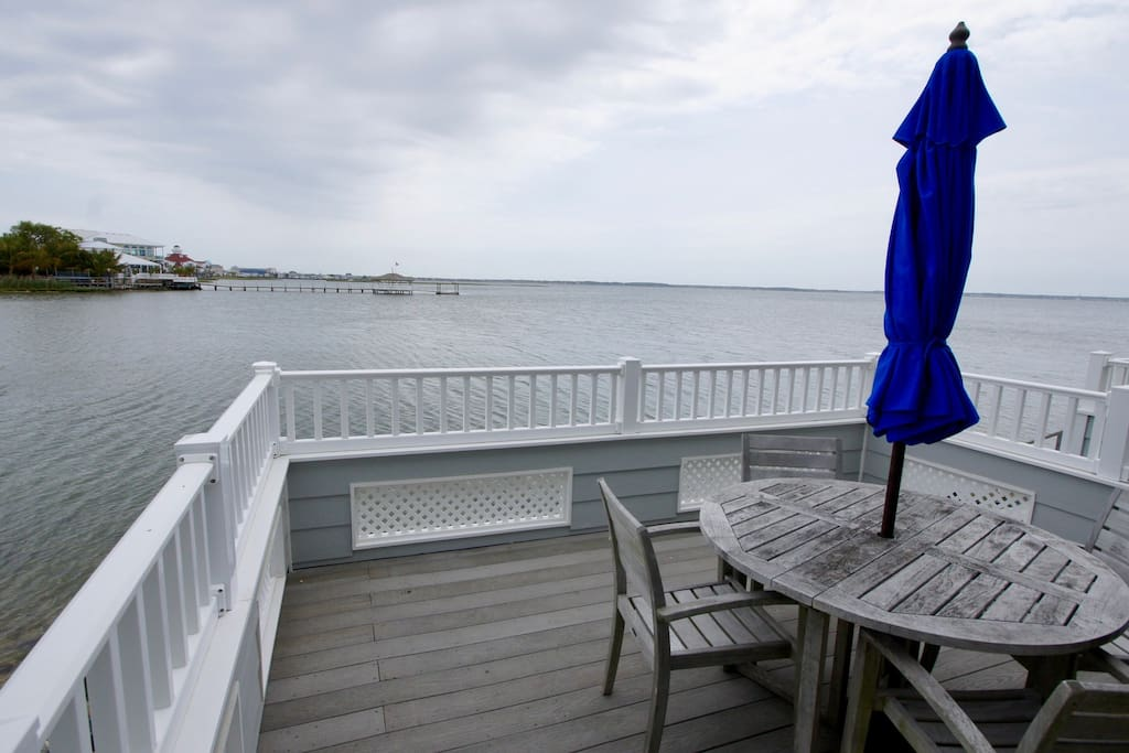 Private waterfront deck with picnic table