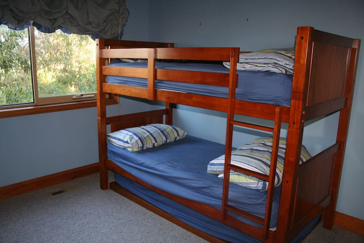 Upstairs bunk bed & trundle