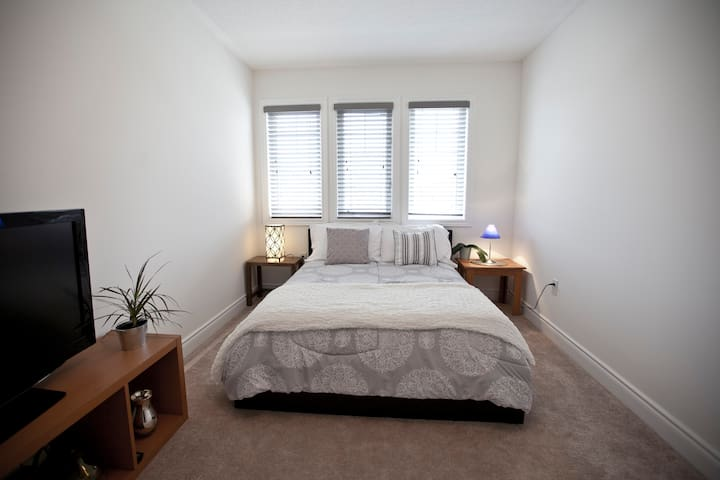Cozy bedroom with double bed and TV