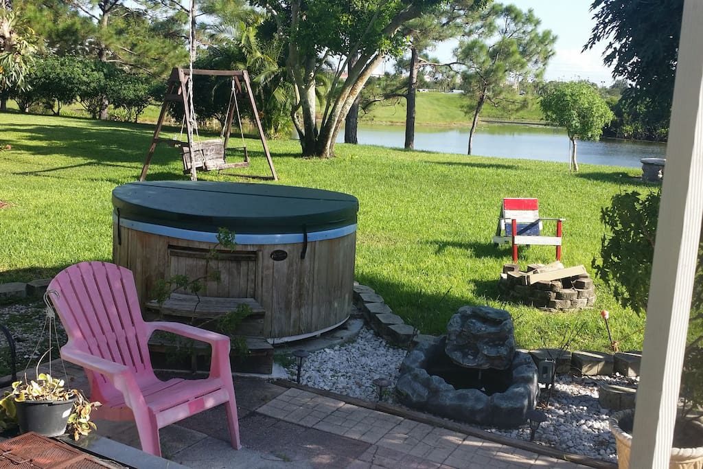 hot tub, fire pit patio and quiet backyard on a lake