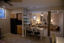 Fridge, microwave, and eating area