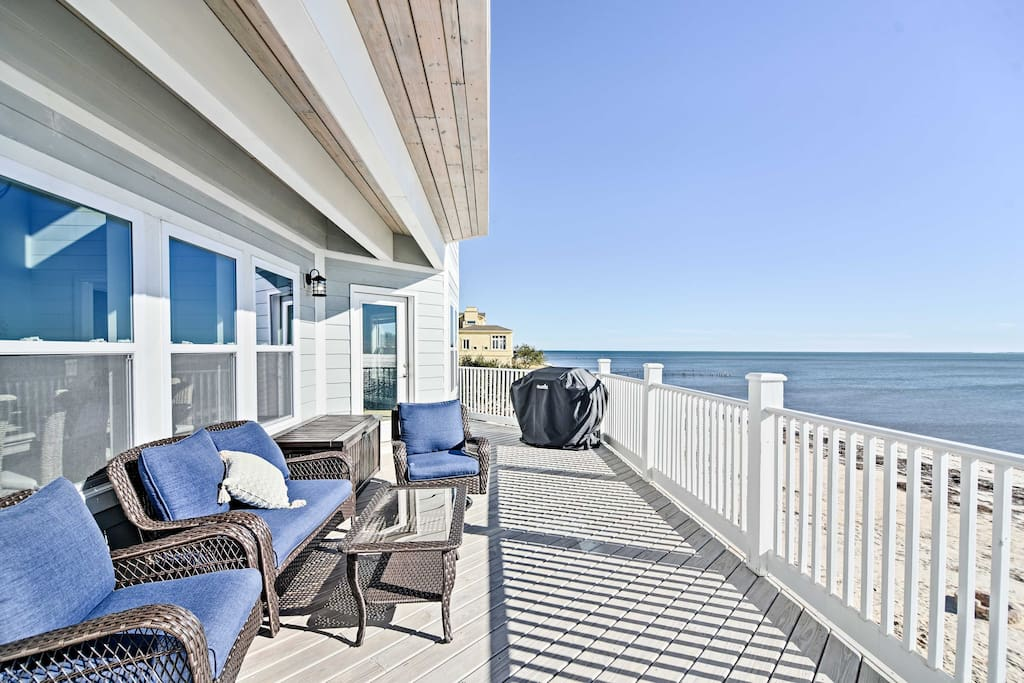 Boasting a furnished deck, private beach, and space for up to 10, this 3,300-square-foot home is truly luxurious.