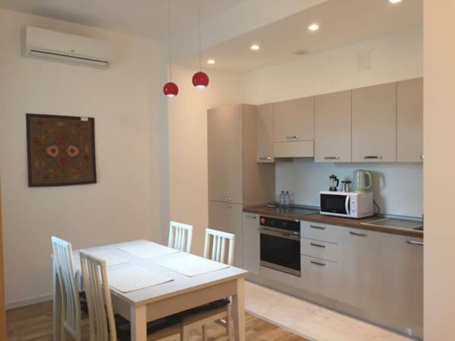a comfortable table, six chairs, a set of dishes for six people, high-quality home appliances, cutlery, refrigerator, oven, stove, in our kitchen you will find everything you need