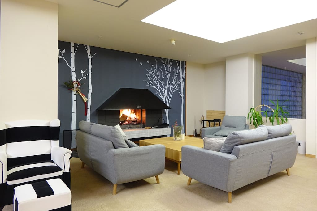 Snuggle up in front of the fireplace with a book, and a hot drink (or cold one) after a day in the powder and a soak in the onsen.