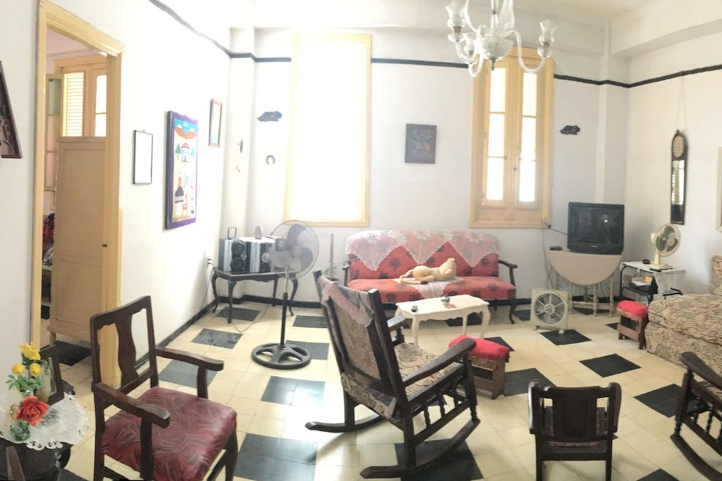 This is the living room of the house. With so much light There are music player, televition, desk, etc...