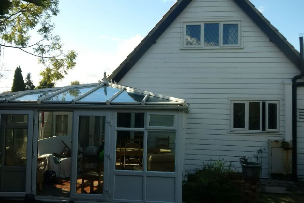 Rear of cottage and conservatory