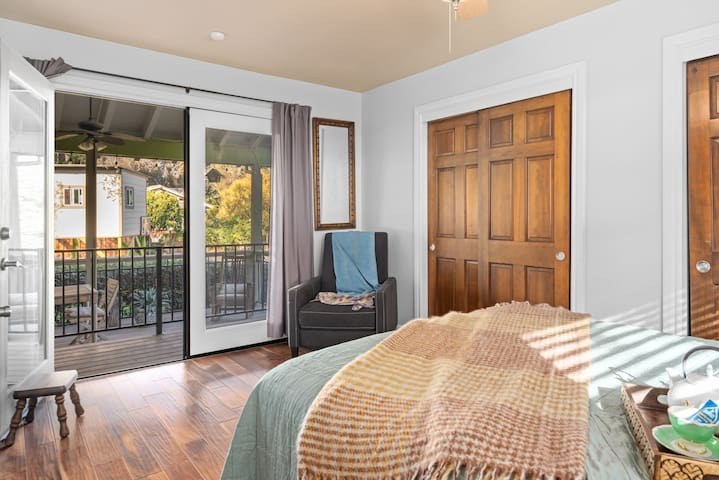 Bedroom with French doors onto front deck