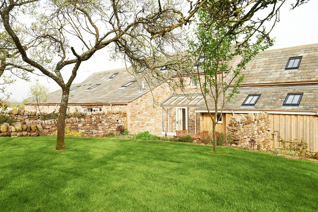 The view across the orchard to the cottage.  Wythburn has a gated and sandstone walled terrace.