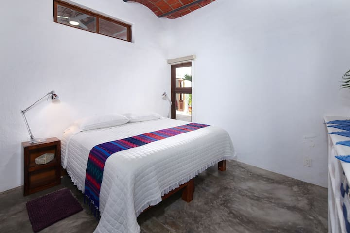 Second bedroom with kingsized bed with private entrance into shared bathroom.