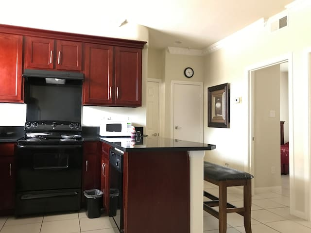 Full size Kitchen, granite countertop, tile floor thru out.