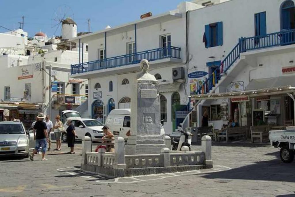 will welcome you to the statue of Manto in Mykonos Town.