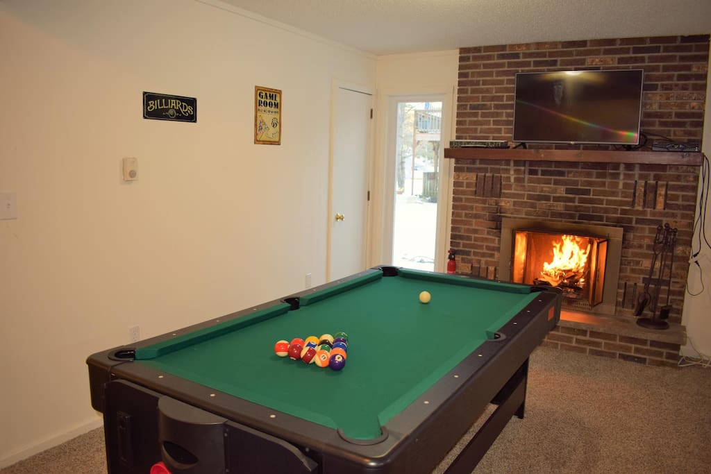 Game room lower level, ping pong, air hockey and pool tables.