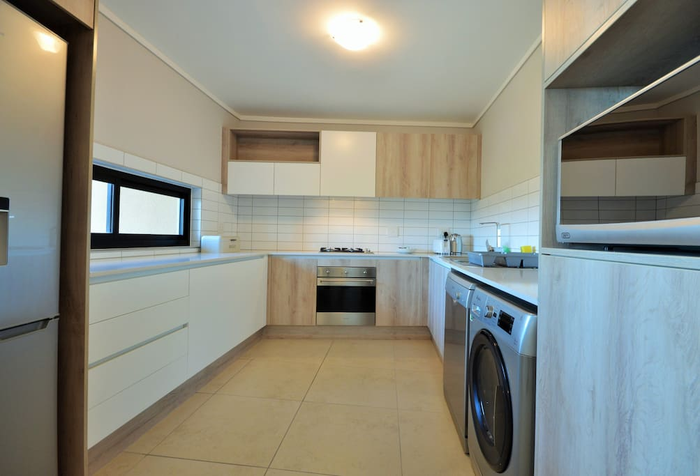 The fully equipped kitchen is fitted with a dishwasher and washer/ dryer and is separate from the sitting room