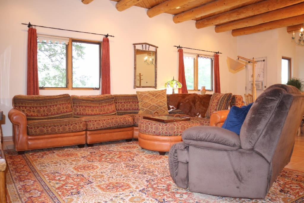 L-shaped super comfy sofa, loveseat recliner & upstairs windows to see the clouds go by