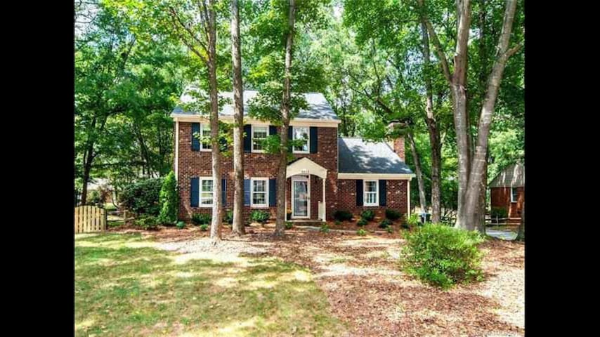 Ballantyne on private wooded 1/2 acre corner lot