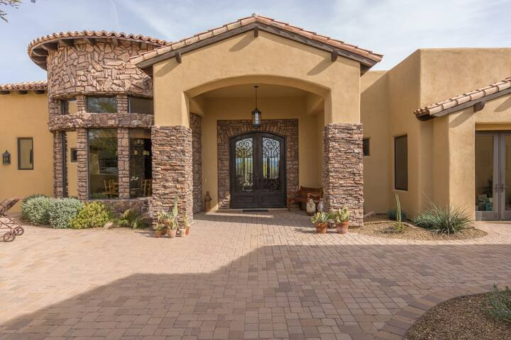 Front entrance - gorgeous Tuscan stone as you enter through the massive front door from the front courtyard.