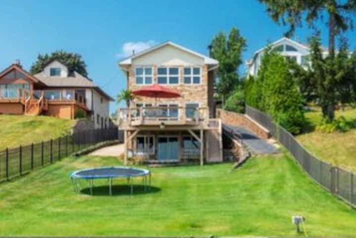 Spectacular Lakefront Retreat With a Heated Pool!