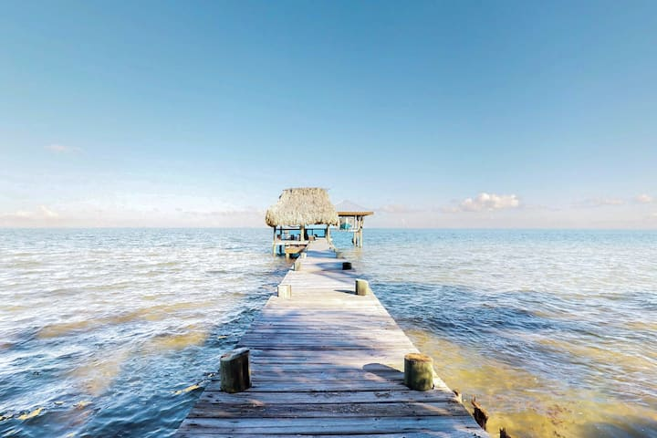 Beachfront home w/ dock, deck, hammocks, strong WiFi, partial AC & sea view