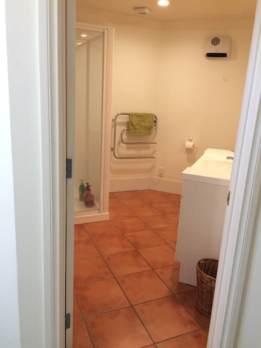 Bathroom with shower directly across hall.