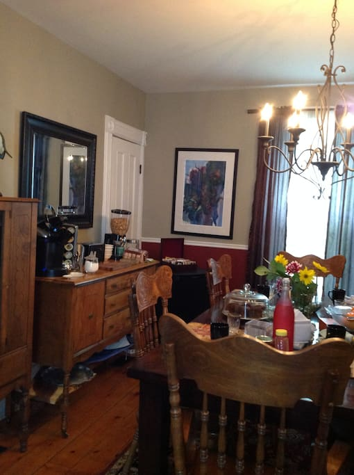 Dining room with toaster and mini fridge where guests can help themselves to a complimentary continental breakfast.