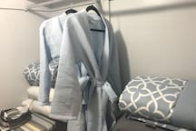 Walk in closet! This is where you'll find extra linens for the sofa sleeper & robes