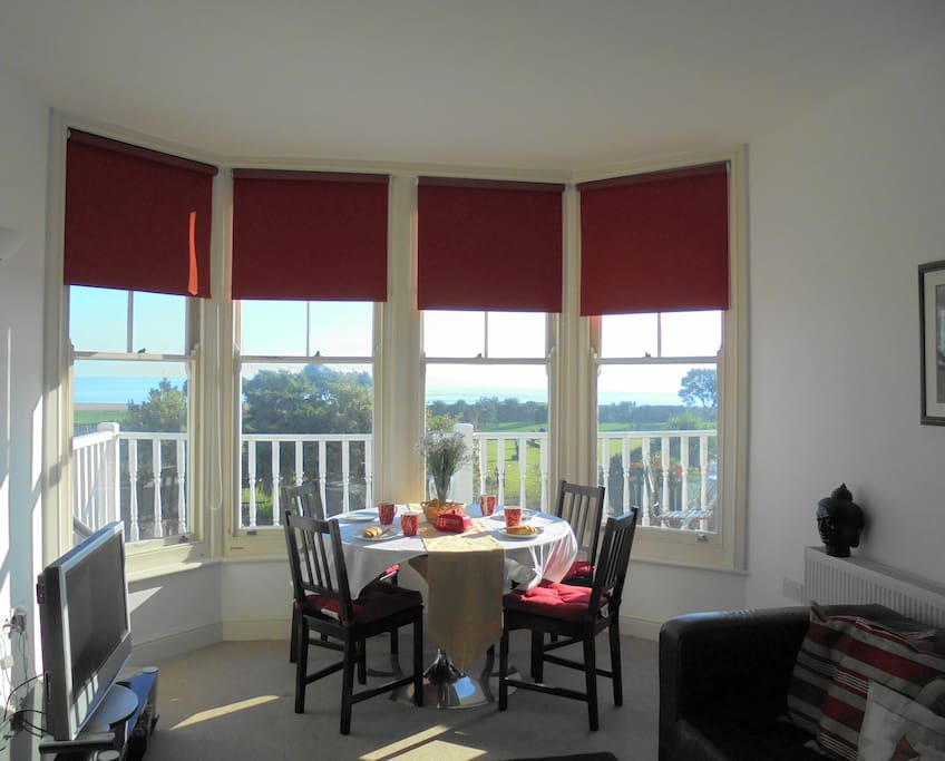 Living/dining room with seaview