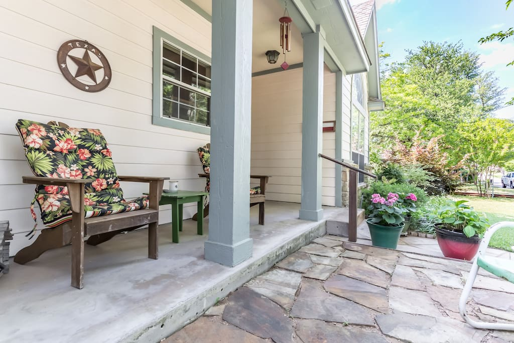 Relax and enjoy the quiet, wooded neighborhood from the front porch.