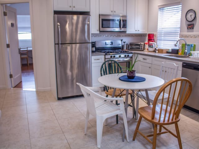 Full kitchen with stove, dishwasher, microwave, and full sized fridge.  Seating for four.  We provide coffee, tea, and some other kitchen basics.