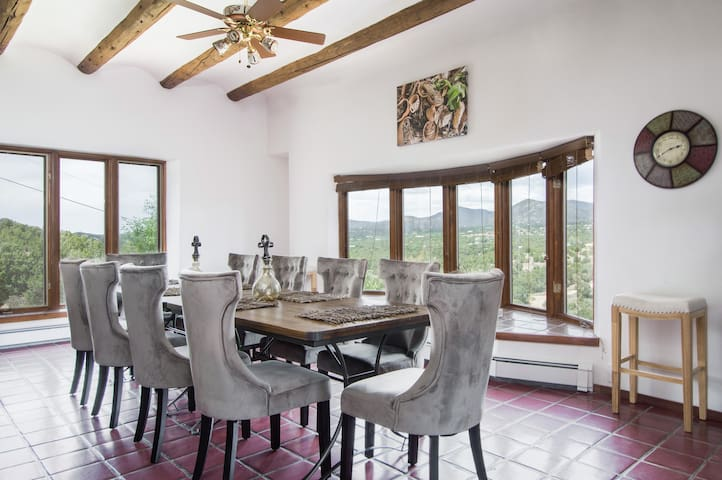 Picture windows boasting mountain views surround the 10-person dining table.