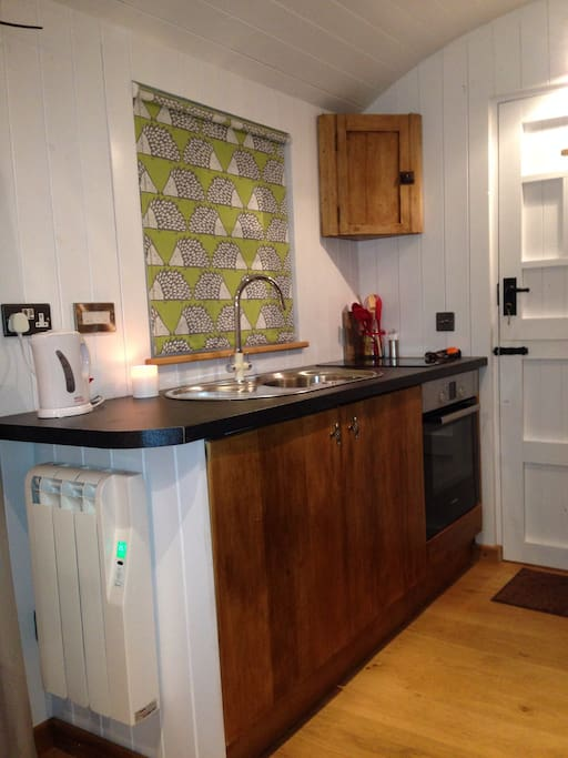 Kitchen with fridge, freezer, hot/cold water, electric oven, ceramic hob. Elm cupboards originally from the farm.