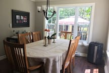 Dining is designed for 6 guests + 3 more chairs and table up to 9 guests.