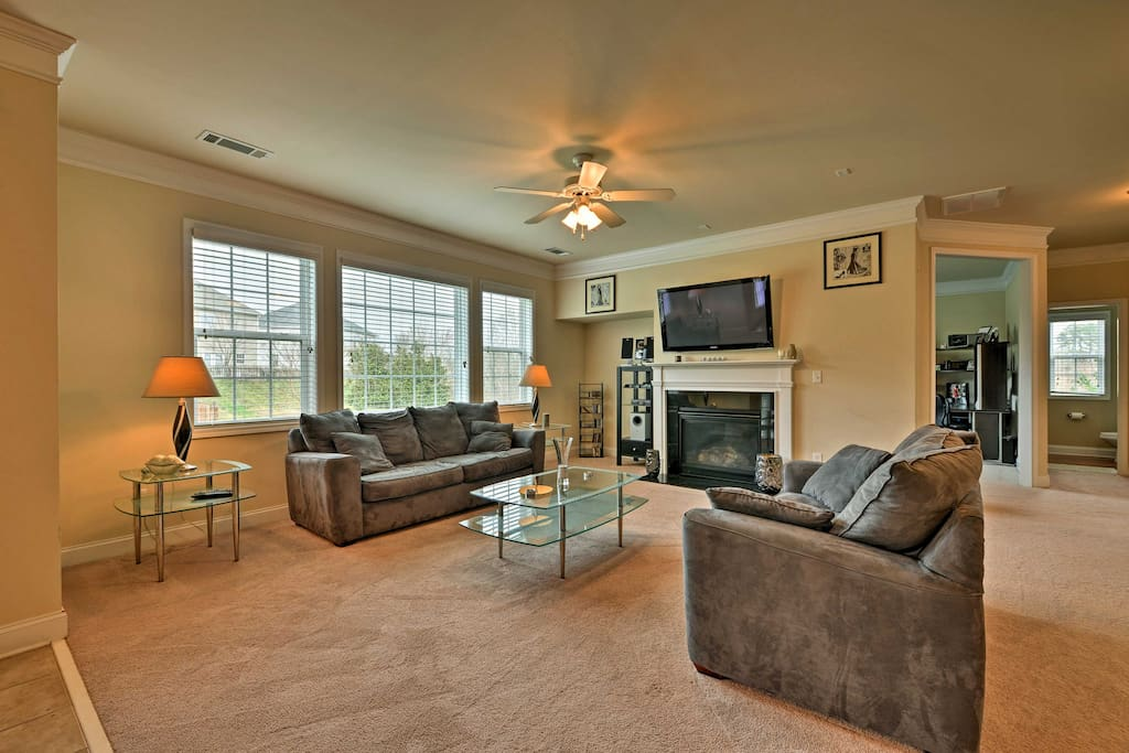 Unwind in the light and airy living area featuring a flat-screen cable TV.