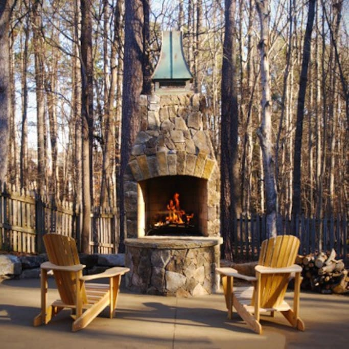 Come enjoy our new outdoor fireplace and adirondack chairs!  Photo courtesy of Shelly White Photography