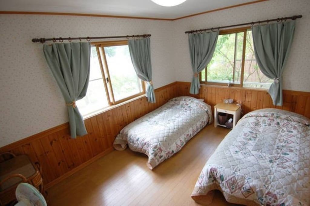 2 100cm wide single beds are in each room.There is an extra bed if  3 people in one room is needed.