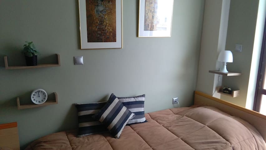 two comfortable single beds with anatomic mattress, clean sheets, warm blanket and reading light
