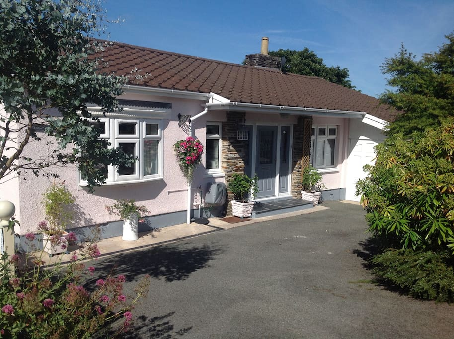 Pretty in pink! Immaculate bungalow with plenty of off street parking for visitors
