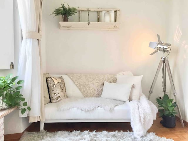 Inspiring and peaceful. A mix of brand new designer pieces and antique window frames repurposed as shelves!