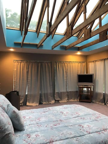Sleep under the stars in the master bedroom. Open the curtains for even more light.