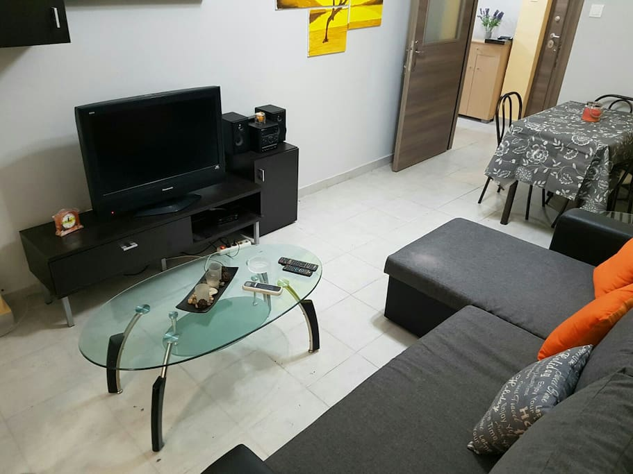 living room - corner sofa which easily becomes a double bed. Air conditioner.  Dining room with 4 chairs. Shelf. Composite TV and Stereo. coffee table. full 4g Wi-Fi.