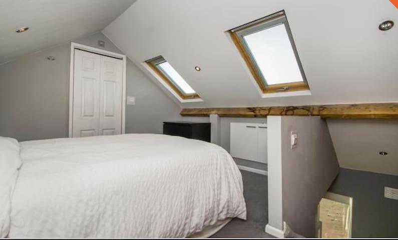 Spacious attic room with private en-suite