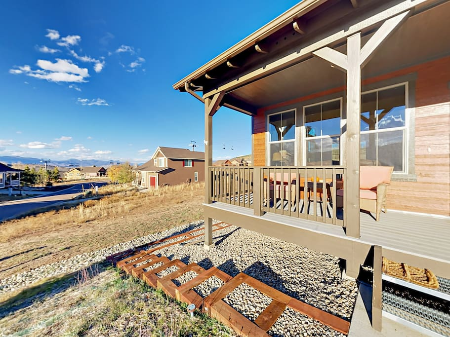 Enjoy blue skies and seating for two on the front porch of this new Granby Ranch home.