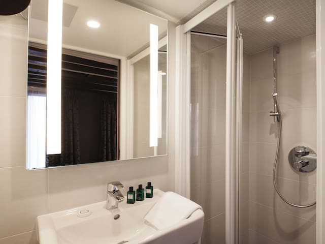 Private bathroom with a shower