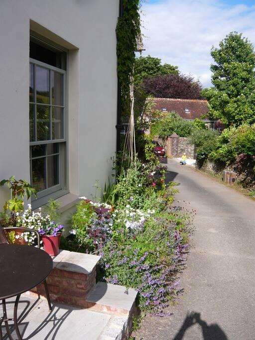 Your downstairs bedroom overlooks the pretty garden
