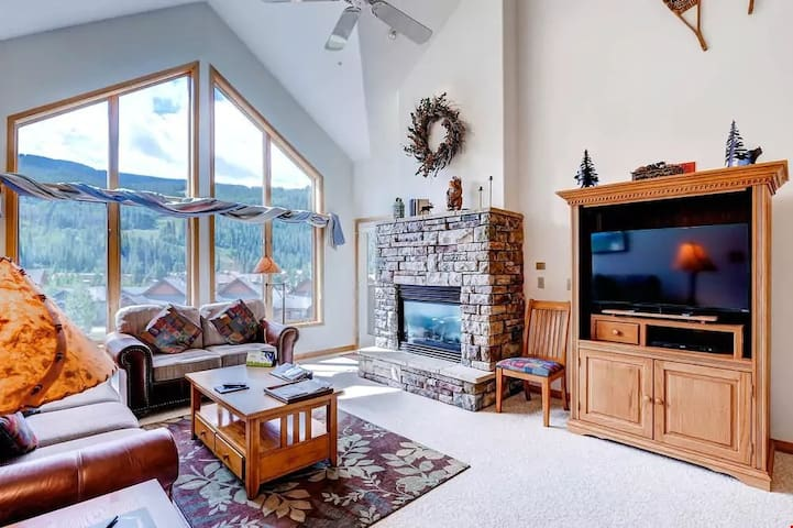Beautiful open living space with amazing large windows! Welcome home! Views may vary.